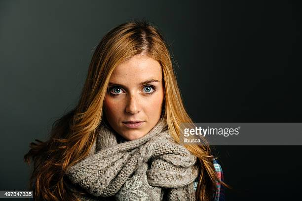 Beautiful young woman with wool scarf