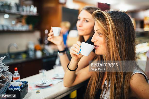 Beautiful Young Women Drinking Coffee At The Bar