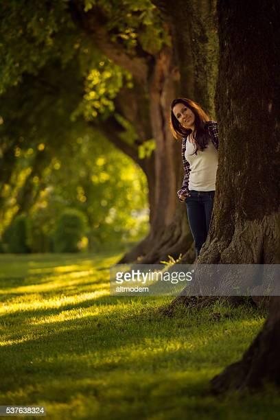 beautiful young women in a park - attraktive frau stockfoto's en -beelden
