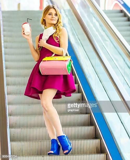Beautiful Young Women Posing on Escalator