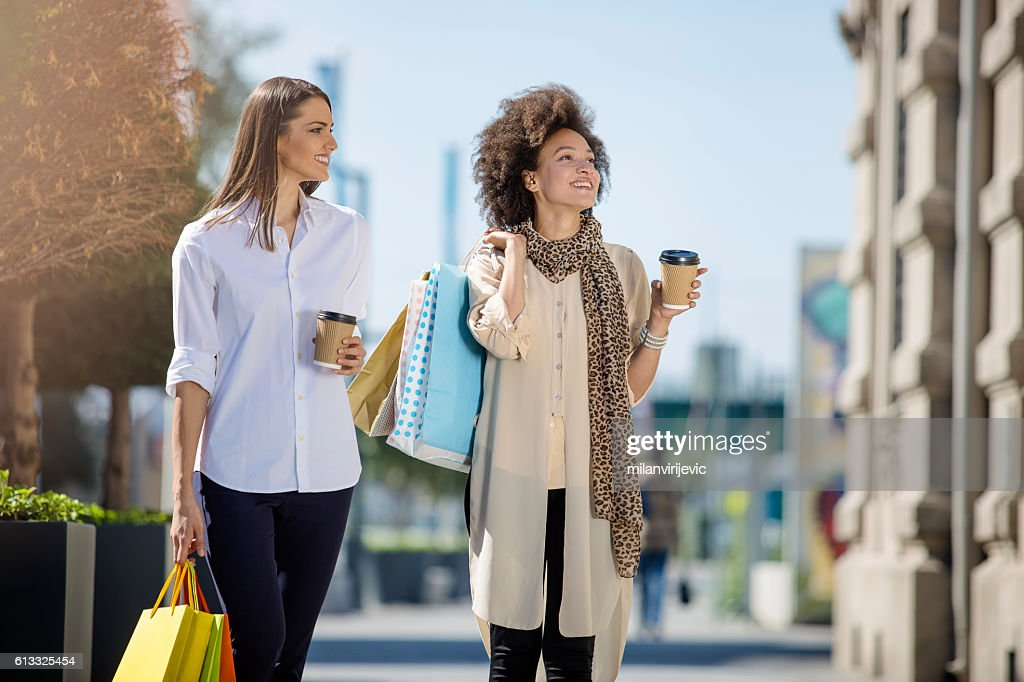 Beautiful young women smiling in the mall : Stock Photo