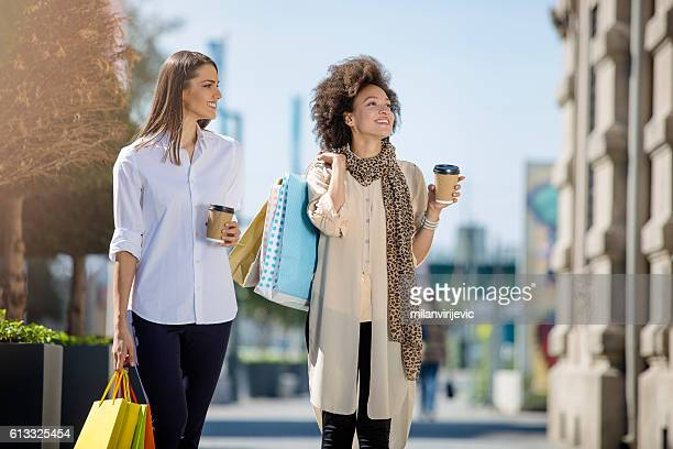 Beautiful young women smiling in the mall