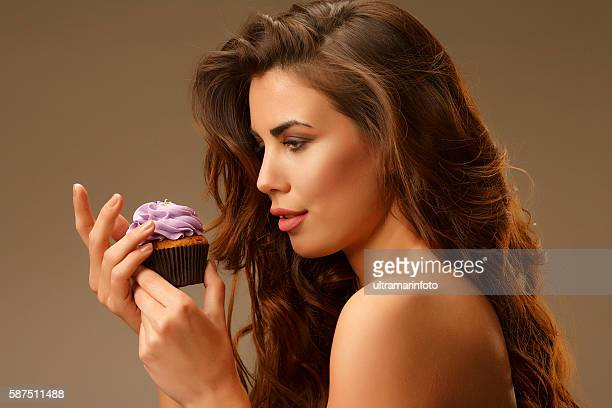Beautiful young women With cupcakes  To eat or not