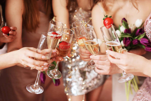beautiful young women's hands hold glasses of champagne. women's party - wedding stock pictures, royalty-free photos & images