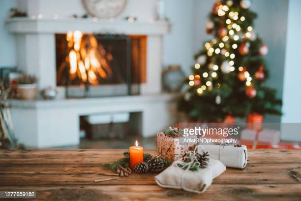 beautifully christmas decorated home  interior with a christmas tree and christmas presents - cosy stock pictures, royalty-free photos & images