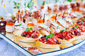 Beautifully decorated catering banquet with different food snacks and appetizers