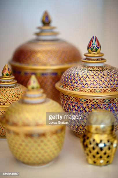 Beautifully designed golden pots and ornaments on a table inside a house in Singapore