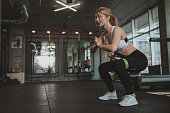 Beautifulyoung athletic woman working out at the gym
