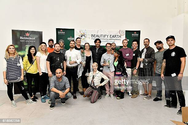 Beautify Hollywood artists pose during the Heineken crowdfunding campaign launch for Beautify Hollywood on October 26 2016 in Los Angeles California