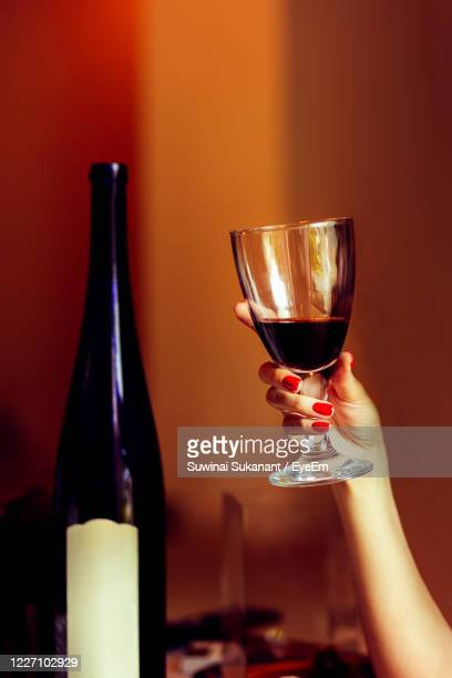 beauty and celebration woman in red manicure holding glass of red wine - drunk woman stock pictures, royalty-free photos & images