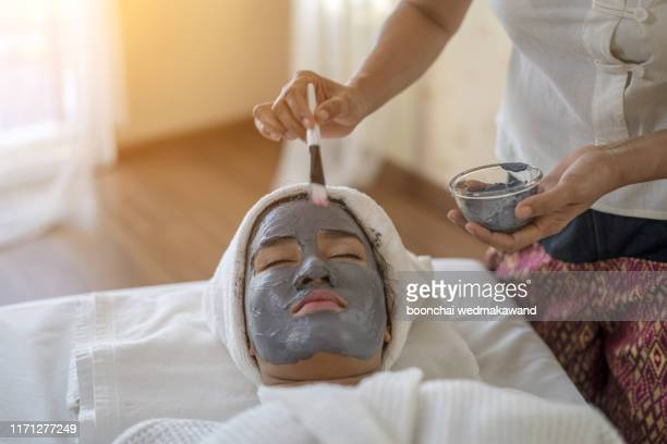 beauty and healthcare. woman in spa salon - beauty treatment stock pictures, royalty-free photos & images