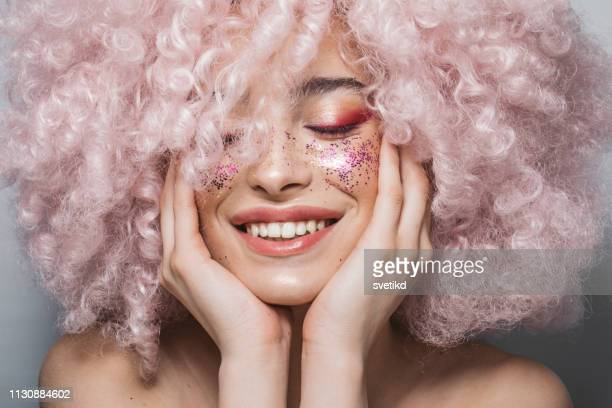 beauty and shine - pink hair stock pictures, royalty-free photos & images