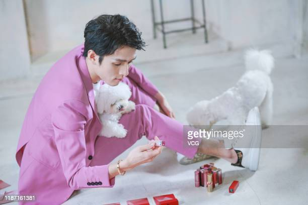 Beauty blogger Austin Li Jiaqi looks at lipsticks aroud his dog on July 14 2018 in Shanghai China 27yearold man Austin Li Jiaqi with a nickname...