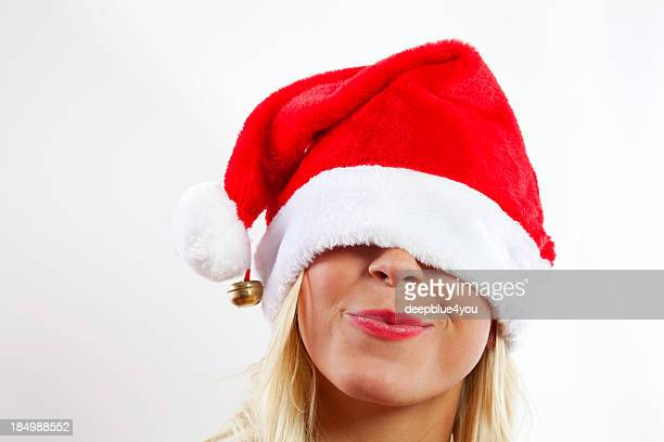 beauty blond female with xmas hood on white - santa face stock photos and pictures