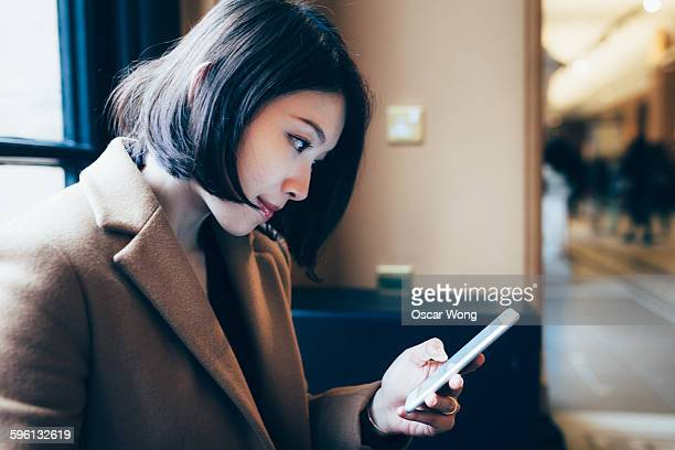 Beauty business woman using smartphone in office
