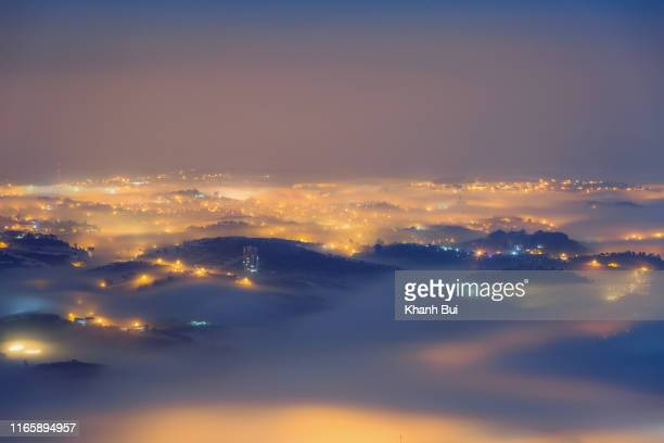 beauty city in the fog at midnight, the magical of light and fog - paranormal stock pictures, royalty-free photos & images