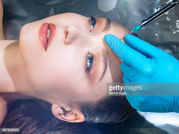 beauty concept shot to cosmetically remove wrinkles - botox stock pictures, royalty-free photos & images