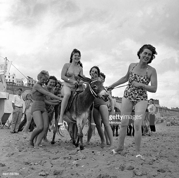 Beauty contest girls playing with a donkey on the beach at Ramsgate 31st August 1960