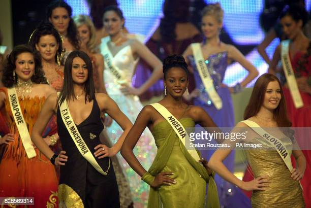 Beauty contestants in the 2002 Miss World competition parade being staged at London's Alexandra Palace after it was moved from Nigeria for political...