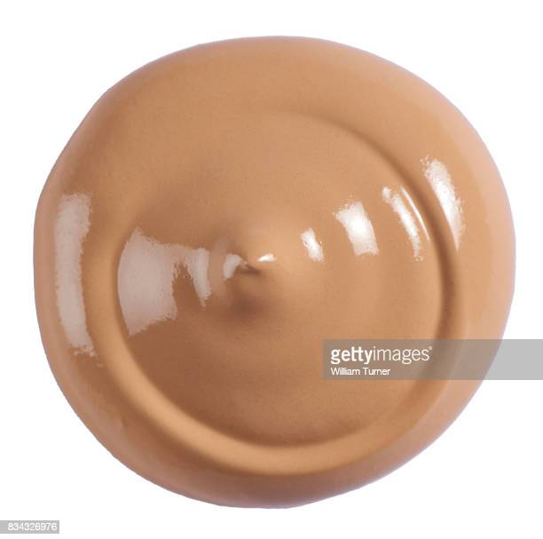 A beauty cut out image of a circle, blob or splodge of tan foundation cream