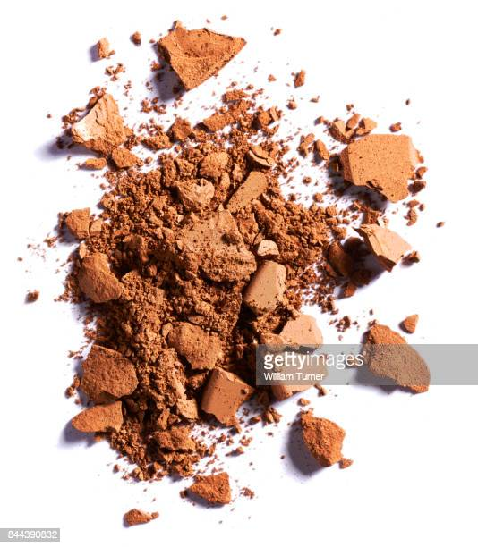 A beauty cut out image of a crushed or broken sample of bronzer make up powder