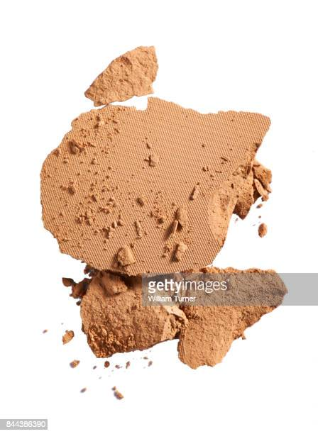 A beauty cut out image of a crushed or broken sample of  make up powder