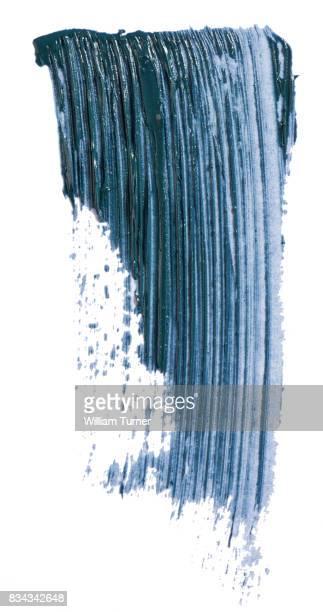 A beauty cut out image of a swipe, smear or scrape of dark blue mascara