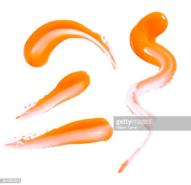 A beauty cut out image of orange lip gloss