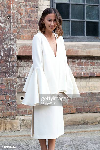 Beauty Editor Eleanor Pendleton wears an Ellery dress and a Daily Edited clutch at MercedesBenz Fashion Week Australia 2015 at Carriageworks on April...