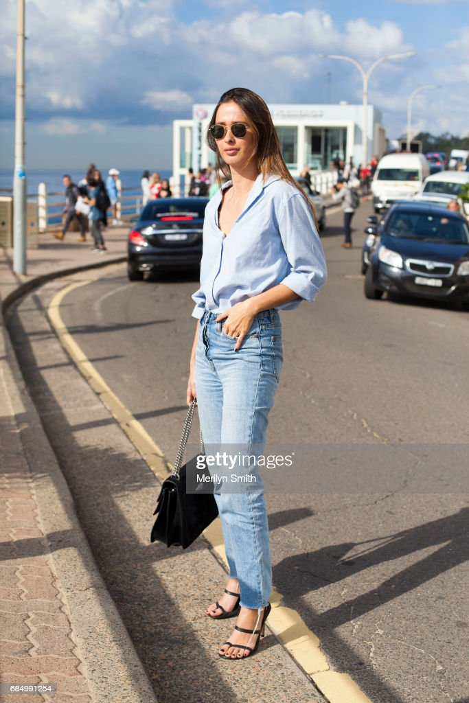 Beauty Editor for Gritty Pretty Eleanor Pendleton wearing Rayban sunglasses, Camilla and Marc jeans, Gucci bag and Tibi shoes during Mercedes-Benz Fashion Week Resort 18 Collections at Carriageworks on May 18, 2017 in Sydney, Australia.