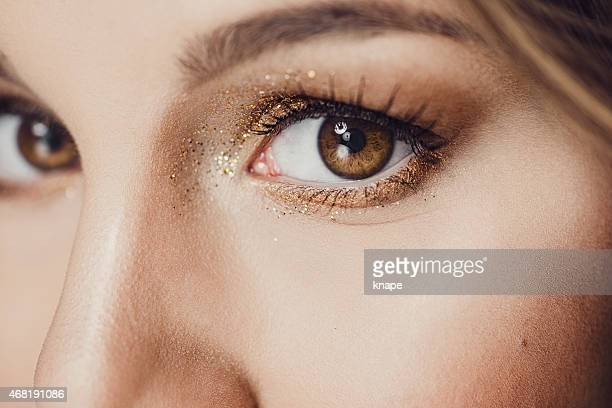 beauty eye close up with glitter - eye make up stock photos and pictures
