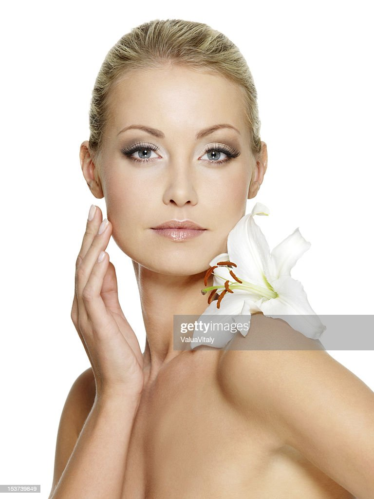 Beauty face of the young beautiful woman with flower stock photo beauty face of the young beautiful woman with flower stock photo izmirmasajfo