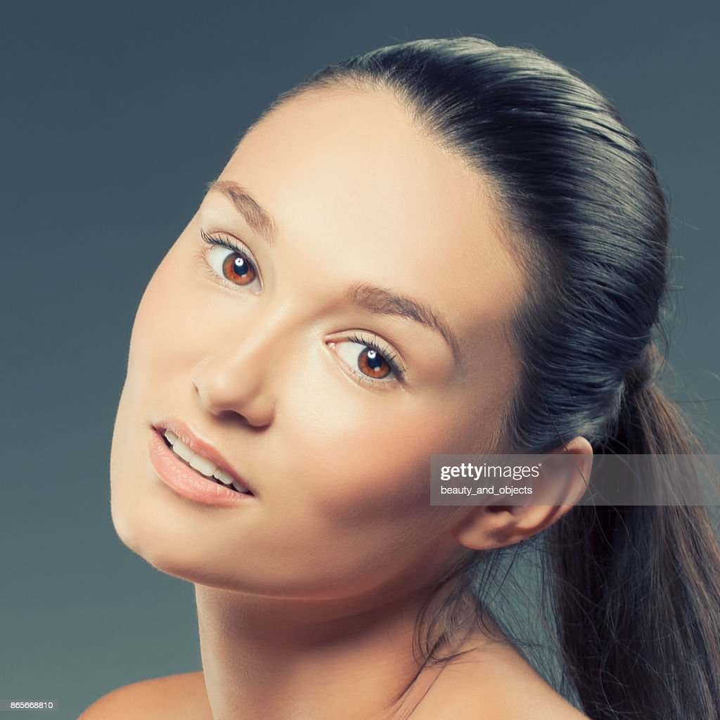 Beauty Face Of Young Model Woman With Clean Fresh Skin Natural