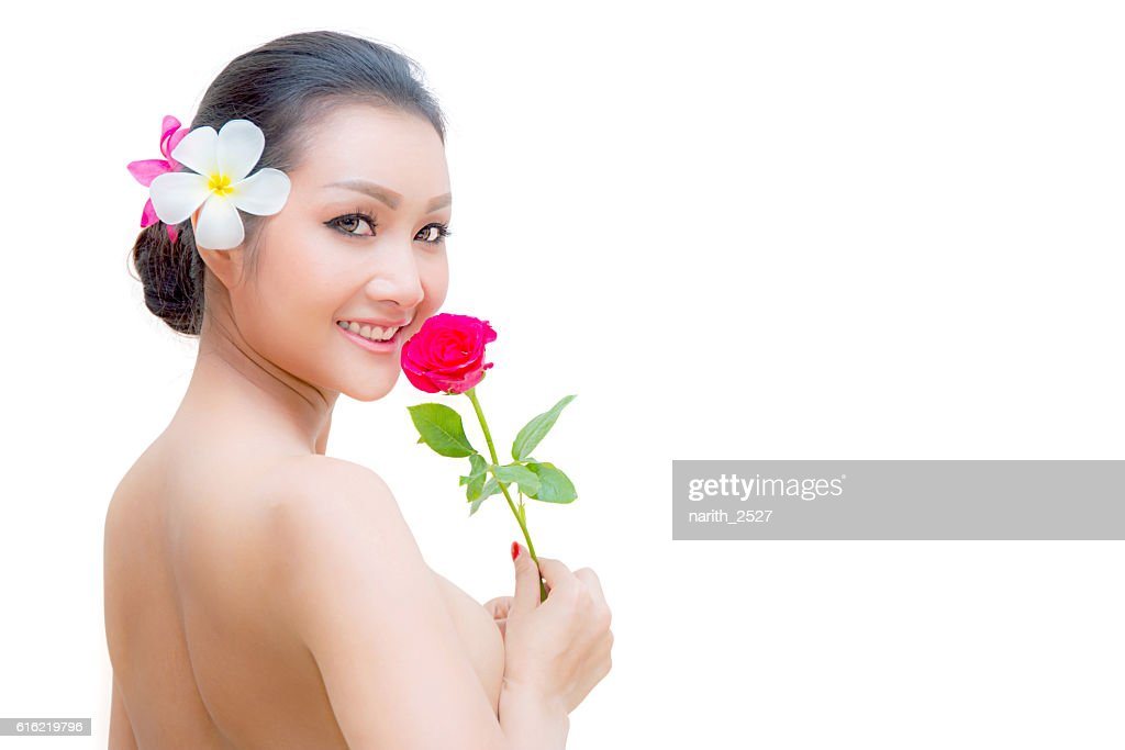 Beauty Fashion Model Woman face. Portrait with Red Rose flower. : Stock Photo