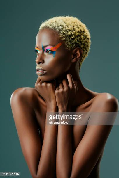 beauty, fashion portrait. original looks. beautiful, lovely and sensual young african girl. attractive african ethnicity, slim women, blonde, short hair. gray wall background. - female body painting stock pictures, royalty-free photos & images