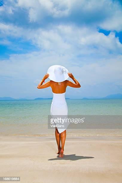 beauty girl in bikini jumping on sea background