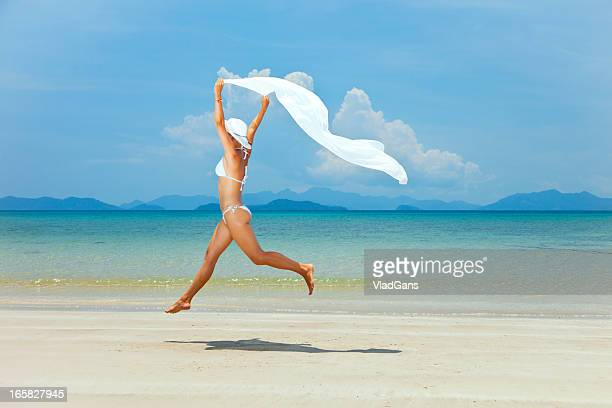 beauty girl jumping on sea background
