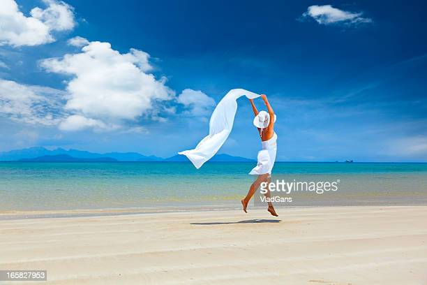 beauty girl jumping on sea background - shawl stock photos and pictures
