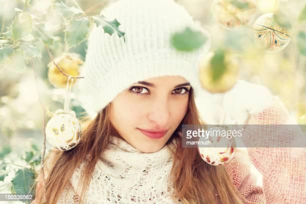 beauty holding christmas ball