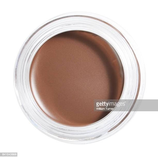 A beauty image of a pot of eye brow colour