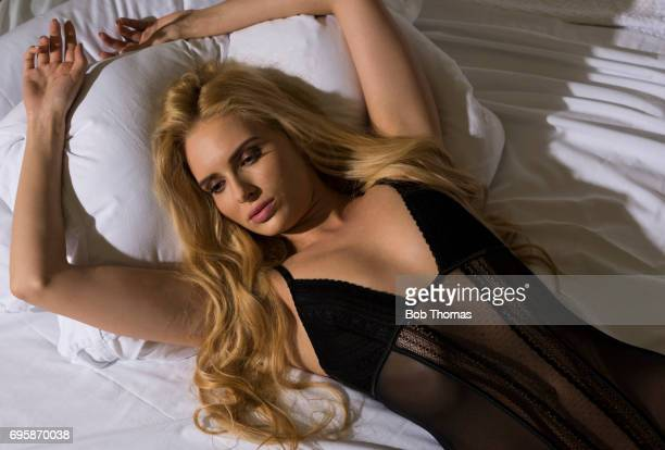 beauty in bed - see thru nightgown stock photos and pictures