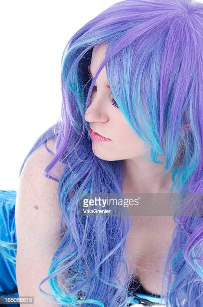 beauty in purple/blue wig leaning forward. - purple hair stock photos and pictures