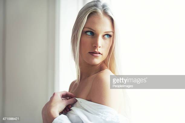 beauty in the bedroom sun - dressed undressed women stockfoto's en -beelden