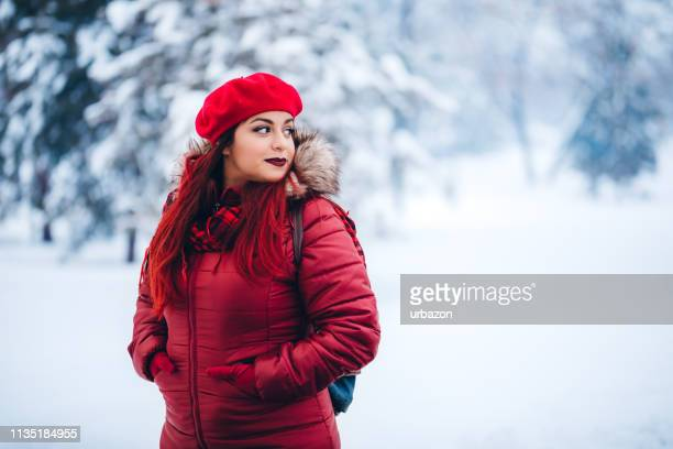 beauty in the snow - hands in pockets stock pictures, royalty-free photos & images