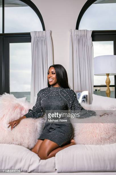 Beauty influencer Jackie Aina is photographed for Buzzfeed on November 18, 2018 at home in Los Angeles, California.