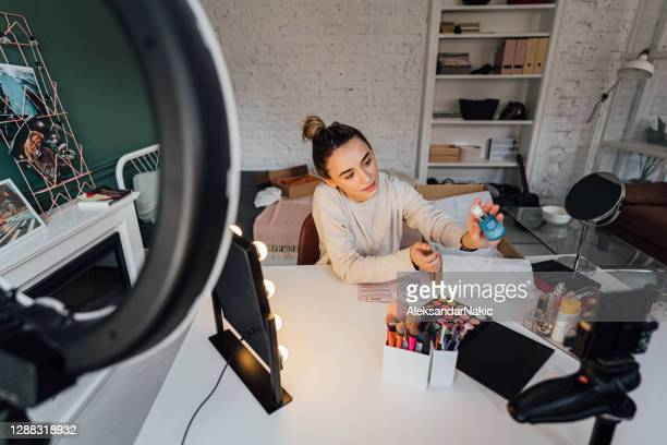beauty influencer testing out new skincare products - unboxing stock pictures, royalty-free photos & images