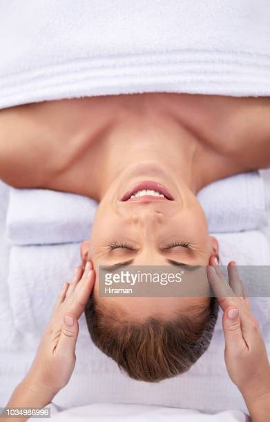 beauty lies in a healthy mind, body and spirit - head massage stock photos and pictures