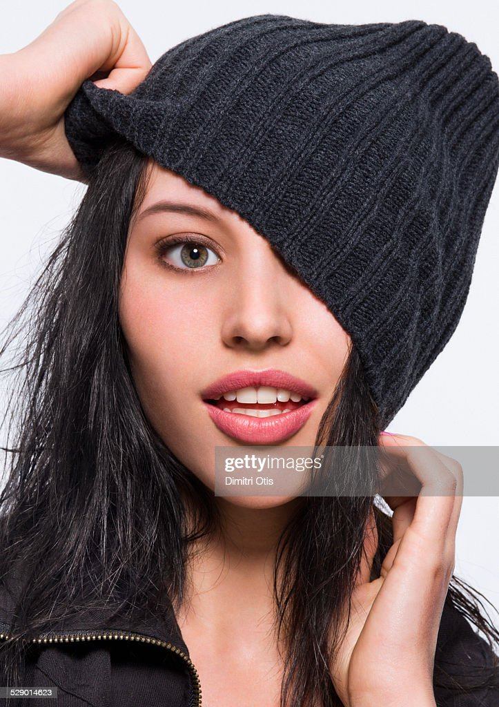 Beauty model pulls wool cape over one of here eyes : Stock Photo