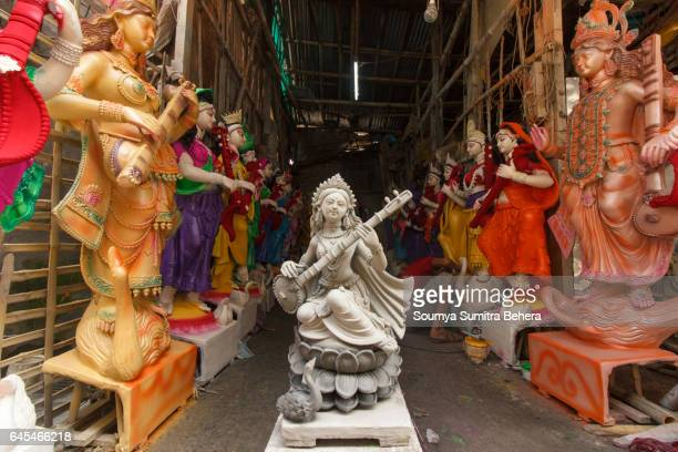 beauty of raw clay - goddess saraswati - saraswati stock photos and pictures