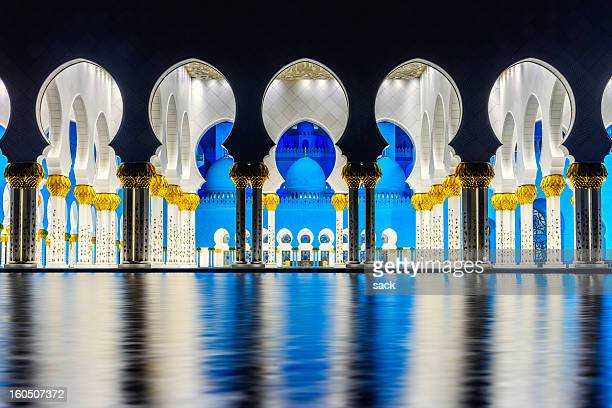 beauty of symmetry at grand mosque abu dhabi - mosque stock pictures, royalty-free photos & images
